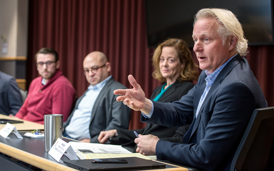 Mark Eppli (right) discusses current topics on a recent faculty panel.