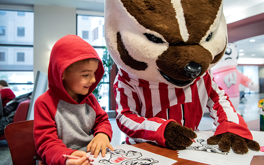 Bucky Badger coloring with a child