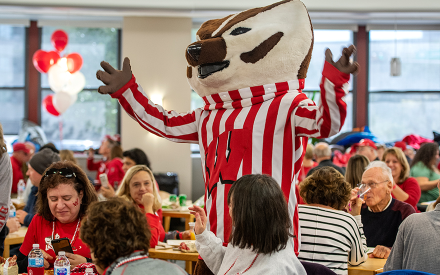 Bucky Badger mingling with alumni