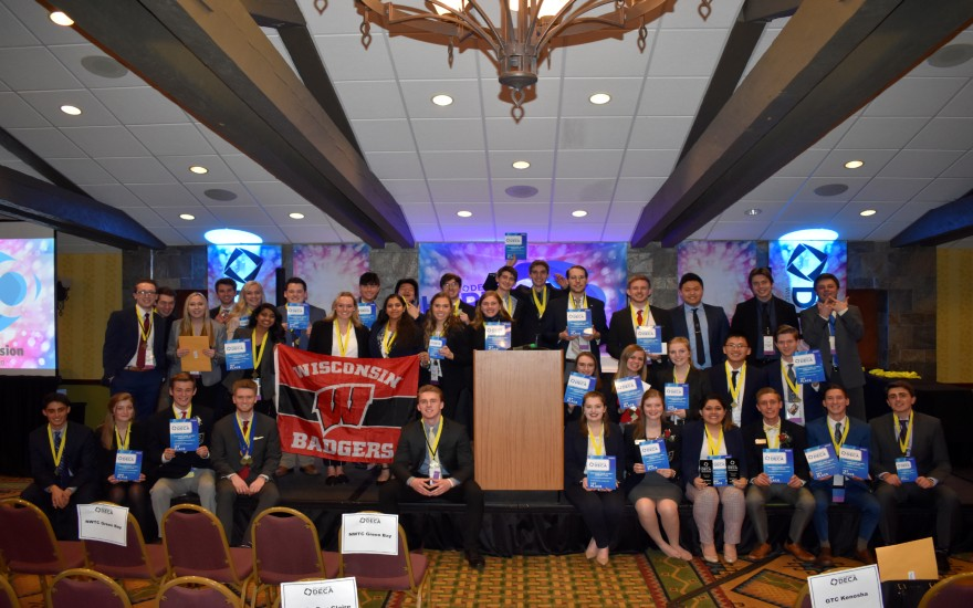 DECA students at the State Conference with medals and awards.