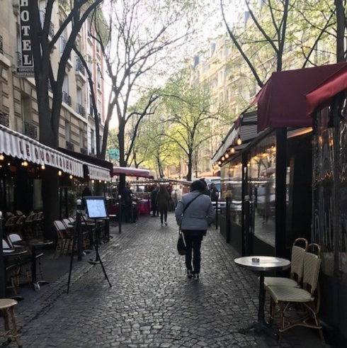 Cobblestone street lined with restaurants