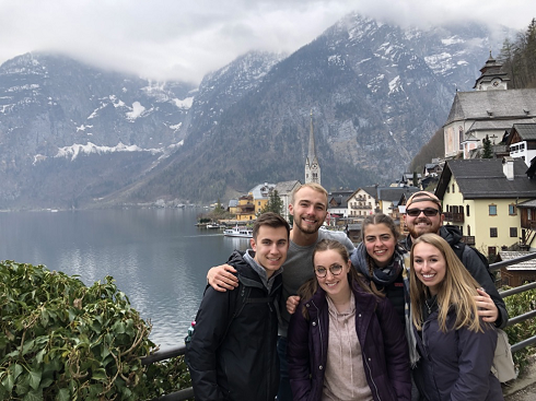 With friends and a snow capped mountain backdrop
