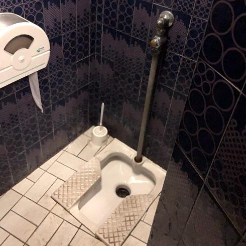 A squat toilet in a restaurant