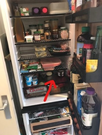 Refrigerator with a red arrow pointing to the shelf I share with my host brother