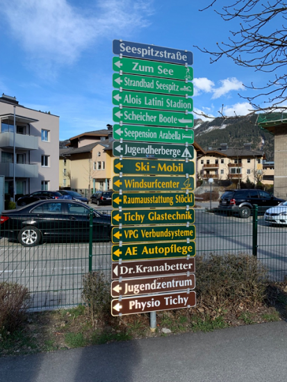 cool street sign with lots of arrows