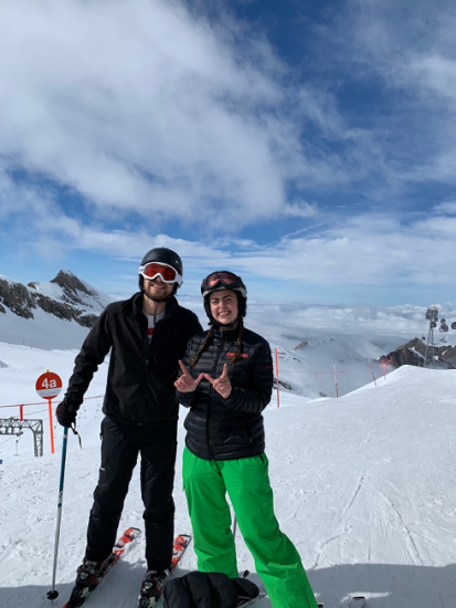 Clouds that blend into the mountains and friends at the top of a ski hill