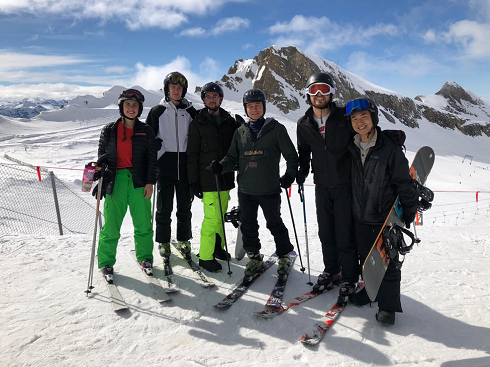 group of friends at the top of the ski hill