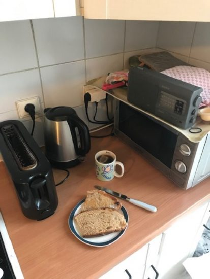 Corner of kitchen with toaster, water boiler, and the microwave