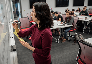 Professor Yang Wang teaches students in an active learning classroom