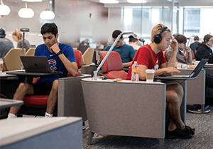 Business students study quietly in the Learning Commons