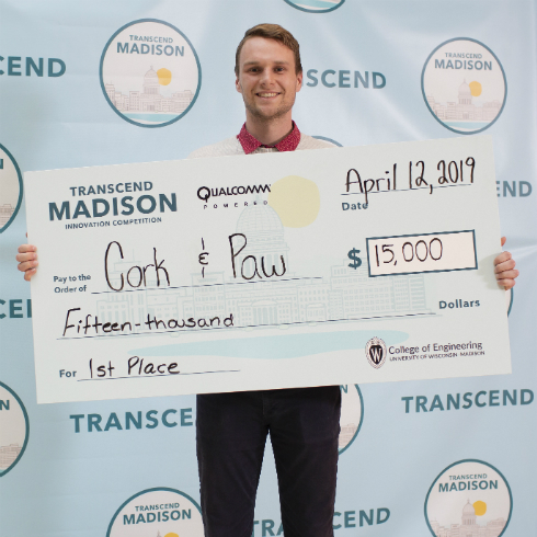 Jack Pawlik holding a giant check