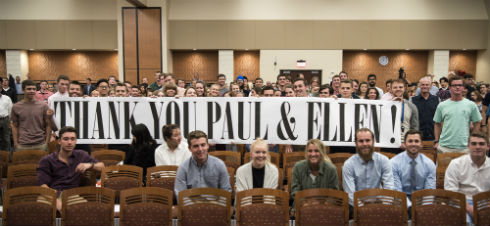 People at the Wisconsin Entrepreneurship Showcase holding up a Thank You Paul and Ellen sign