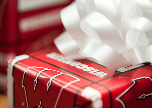 Present wrapped in University of Wisconsin wrapping paper