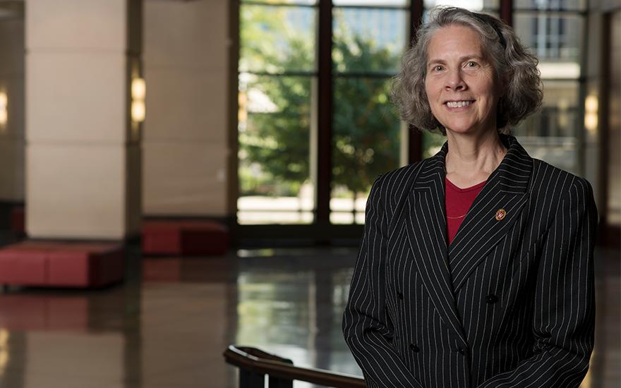 WSB Professor Joan Schmit stands for a portrait in Grainger Hall
