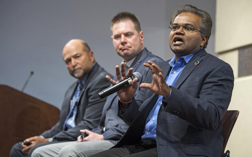 Three panel speakers present on a stage