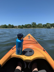 kayak on lake with water bottle
