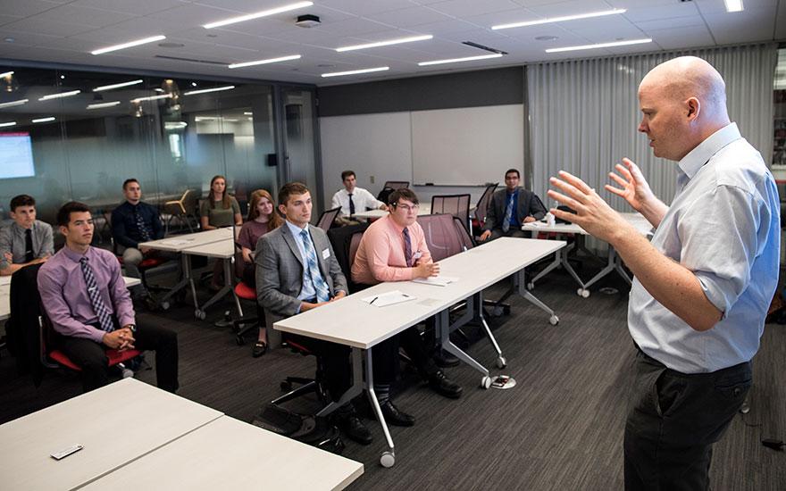 Professor Enno Siemsen speaks to students during a PharmD orientation