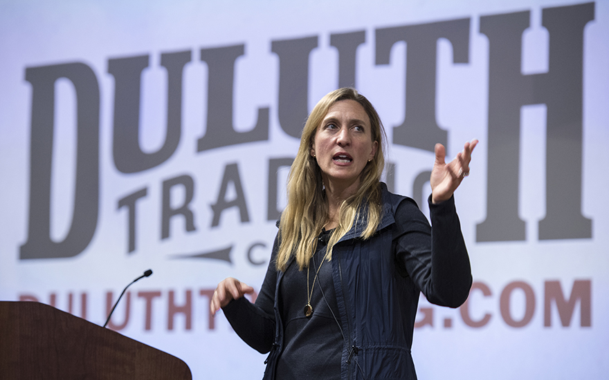 CEO Stephanie Pugliese speaks against a backdrop of the Duluth Trading Company logo