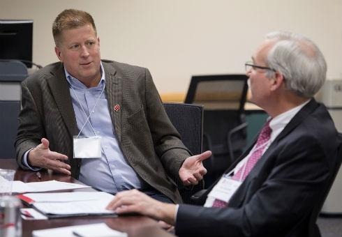 Dan Kelly talks to board member