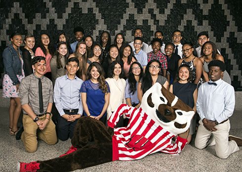 The inaugural BEL Program scholars spend some time with Bucky Badger at Grainger Hall.