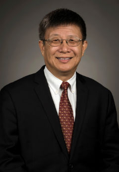 Vertical portrait of Professor Yongheng Deng