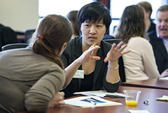 Sarah Freye (BBA '09) (left), quality assurance team lead manager at Epic, listens as she and Nicole Chi (MBA '16) participate in the Accelerating Leadership Development Through Coaching seminar at the HR Summit this spring at the Wisconsin School of Business.