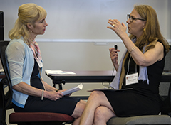 Anne Marie Pernice (right) of Medtronic, shows the class how to be a better listener as she role play with her coworker Ann Houser, (left) during the Accelerating Leadership Development Through Coaching seminar, while at the WSB 2016 HR Summit.