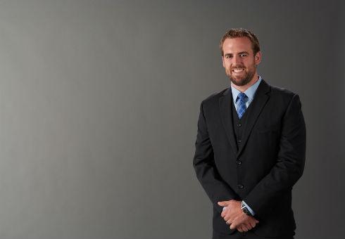 Portrait of Paul Hoban in suit