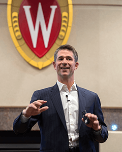 A photo of Kevin Conroy speaking to Wisconsin MBA students