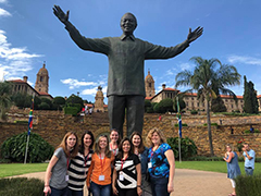 Wisconsin MBA students stand next to a Mandela statue in Pretoria