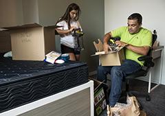 Thiel unpacking a box
