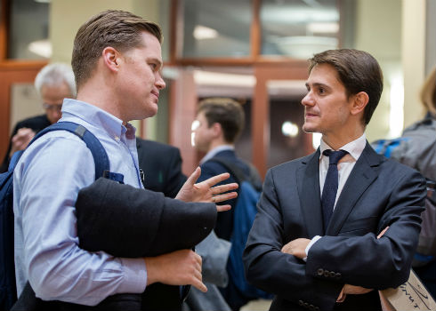 Student Ben Steven (MBA '17) talks with Assistant Professor Jaime Luque at the affordable housing event