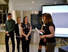 Caroline Levine and Suzanne Dove present Best Pitch award to students