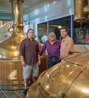 Professor Tom O'Guinn and MBA student Tim tour Capital Brewery with Richard King.