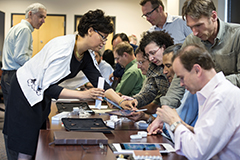 Leslie Petty (left), assistant dean of the Executive and Evening MBA Program at the Wisconsin School of Business, helps Wisconsin Executive MBA Program faculty set up their iPad Pro tablets during a summer training session.