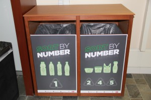 Recycling signage with sorting information displayed