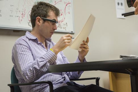 Ph.D. candidate Adam Spencer uses Google Glass to record feedback.
