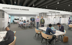 Students work at tables near the active learning classrooms in this architectural design