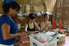 An image of three women packing soap in Ecuador