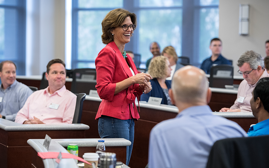 Faculty Associate Deb Houden teaches Executive MBA students in a Grainger Hall classroom.