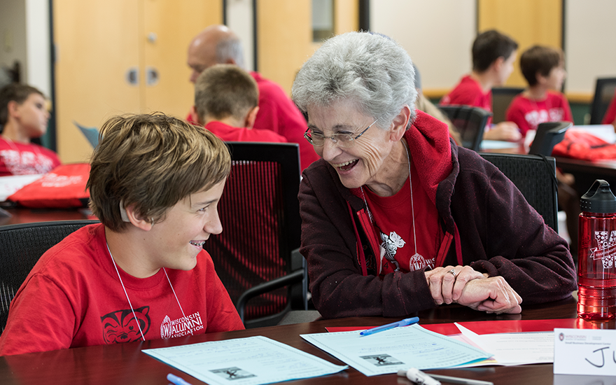 A grandmother and her grandson enjoy learning together during Grandparents University.