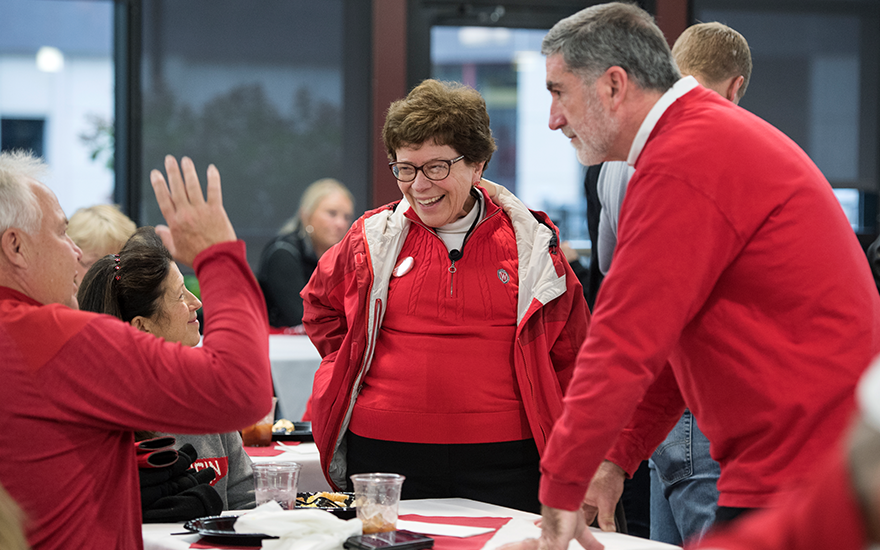 Chancellor Becky Blank and Interim Dean Barry Gerhart greet alumni at WSB's Homecoming Bash.