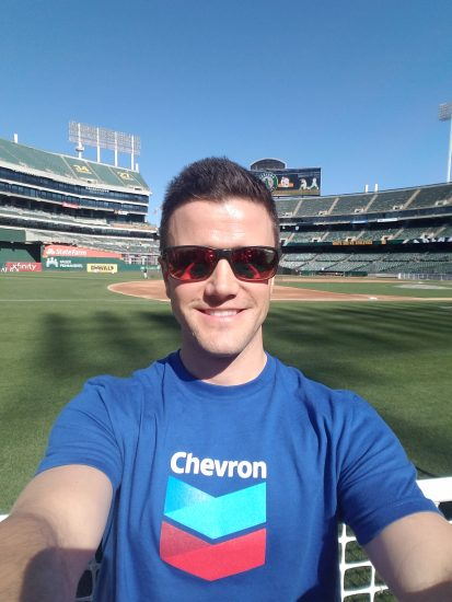 Joshua wears Chevron shirt at baseball stadium event