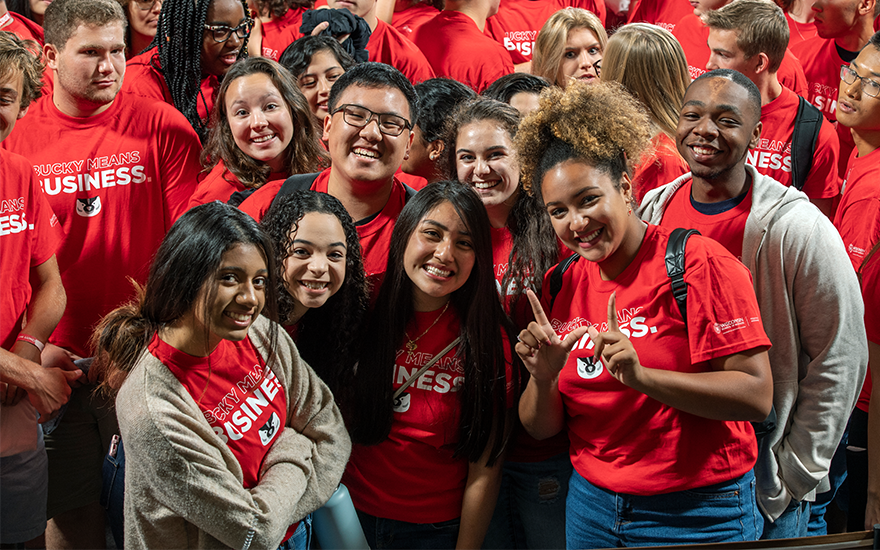 "First-year students pose for a picture while making the ""W"" for UW-Madison"