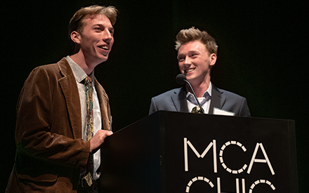 WSB students David Smith and Chase Devens give an acceptance speech after winning a study abroad film festival.