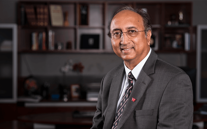 A portrait of WSB Dean Vallabh Sambamurthy in his office