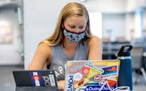 A business student uses her laptop