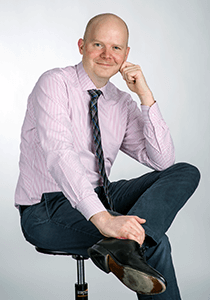 Professor Enno Siemsen poses for a portrait.