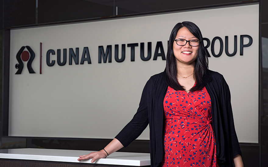 Yuexin (Ivy) Cao stands in front of CUNA Mutual Group sign