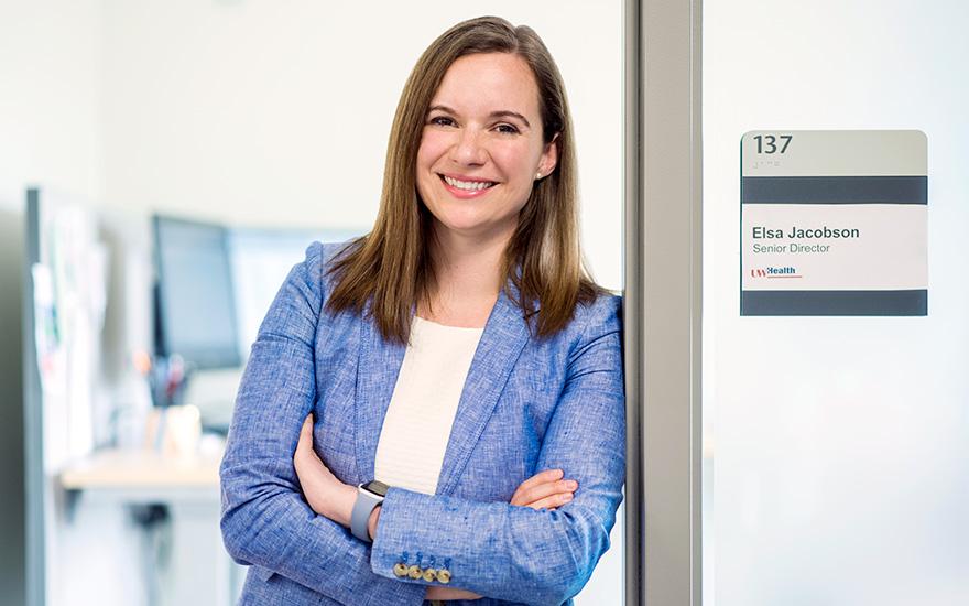 Elsa Jacobson stands in her office doorway